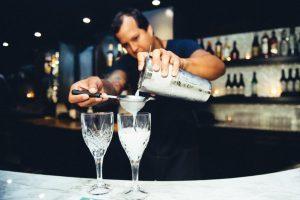 Man Pouring Cocktail At Bar