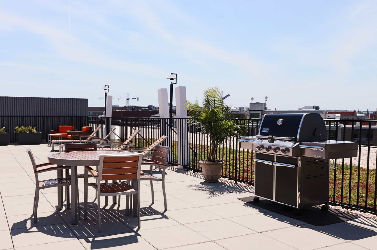 Hamilton House Rooftop Patio With Grill and Chairs