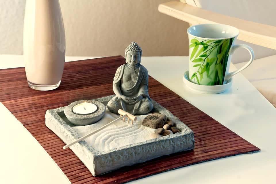 Miniature Buddha Statue and Sand Garden