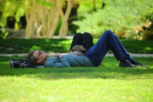man-laying-down-in-park