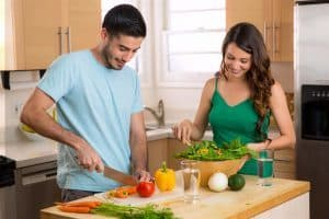 Husband and Wife Making A Dinner Salad