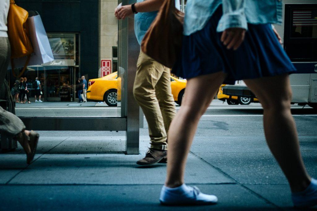People Walking On A Sidewalk In DC