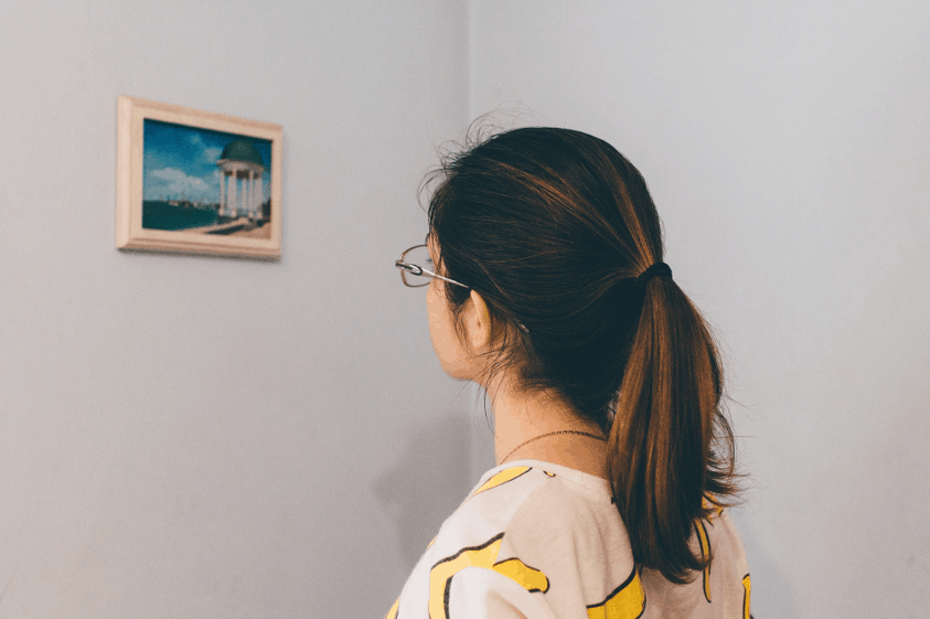 Woman at a Museum Looking at a Picture