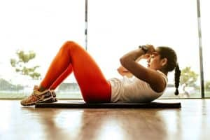 Woman Doing Crunches in Her Apartment